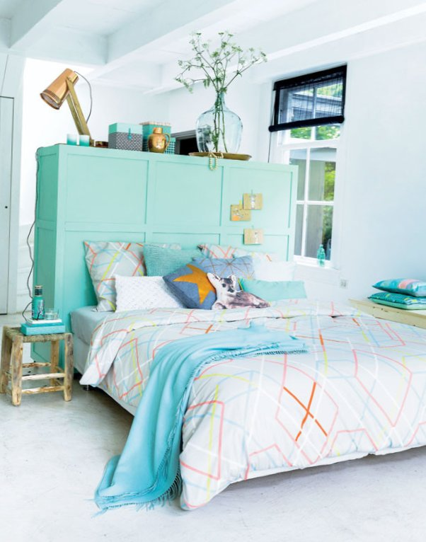Turquoise bedroom with creative headboard-1